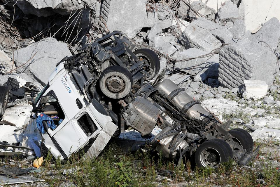 A crushed truck is seen at the collapsed Morandi Bridge site in the port city of Genoa, Italy. August 14, 2018.