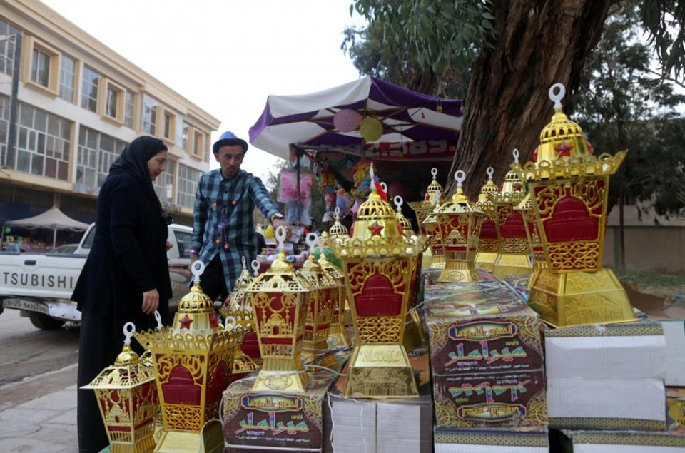 A woman buys toys ahead of celebrations marking the religious holiday of Mawlid in Benghazi, Libya.