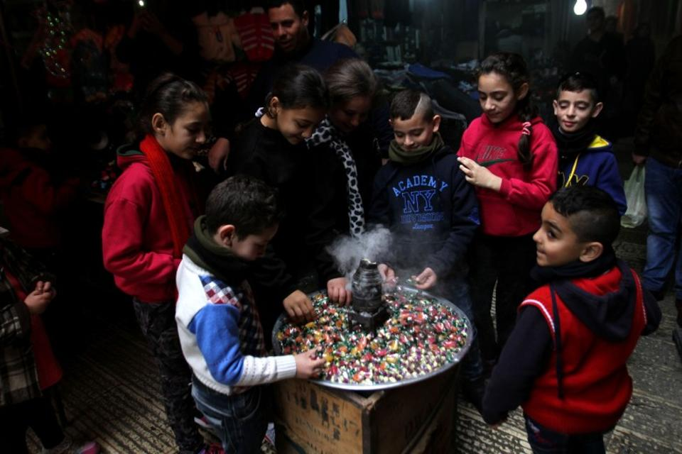 Sweets are widely distributed among the children during Mawlid celebrations in Nablus, Palestine.