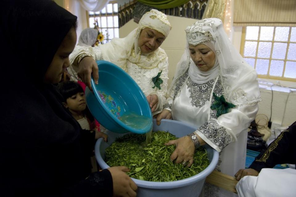 Keeping the tradition alive, Muslim women and children in Cape Town, South Africa, in their finest clothes cut lemon and orange tree leaves while reciting salutations upon the Prophet.