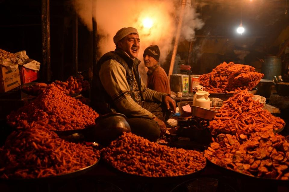 A vendor sells traditional snacks to devotees at Kashmir's holiest shrine, Hazratbal in Srinagar, Kashmir.