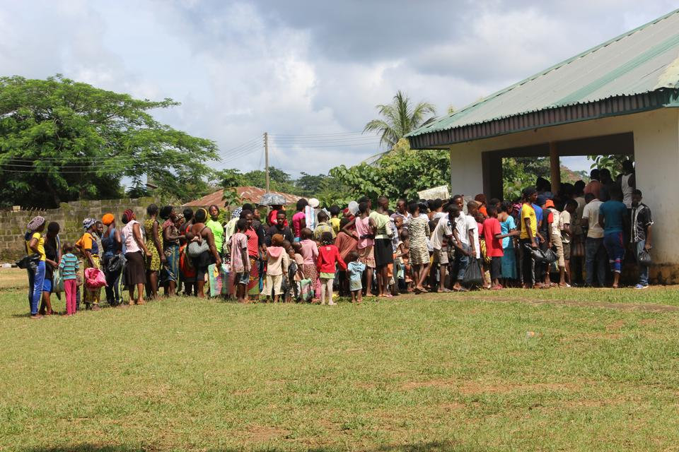 Cameroonian refugees in Agbokim Waterfall village wait outside a centre to receive assistance.