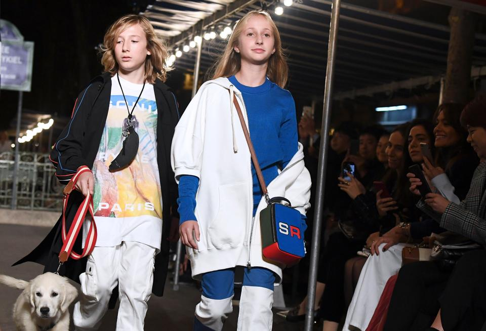 fa62de5858a Children with a dog present creations by Sonia Rykiel during the  Spring-Summer 2019 Ready