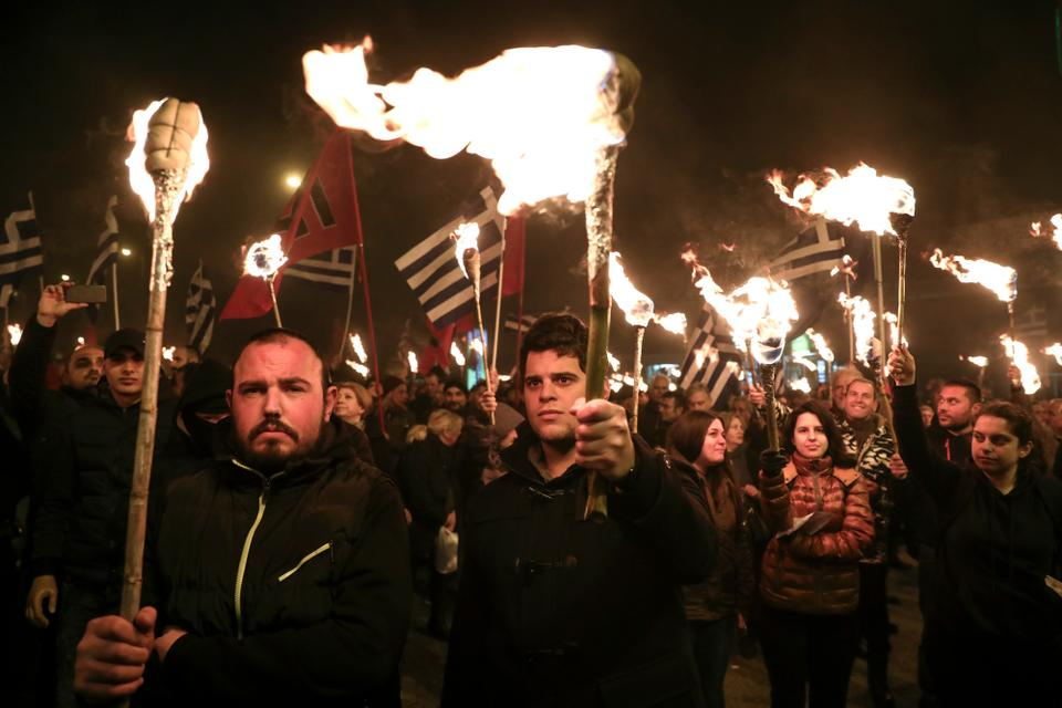 Supporters of Greece's extreme right Golden Dawn party raise torches during a rally in Athens, February 3, 2018. Golden Dawn was founded as a neo-Nazi group during the early 1980s and is currently the third-largest party in Greece's Parliament.