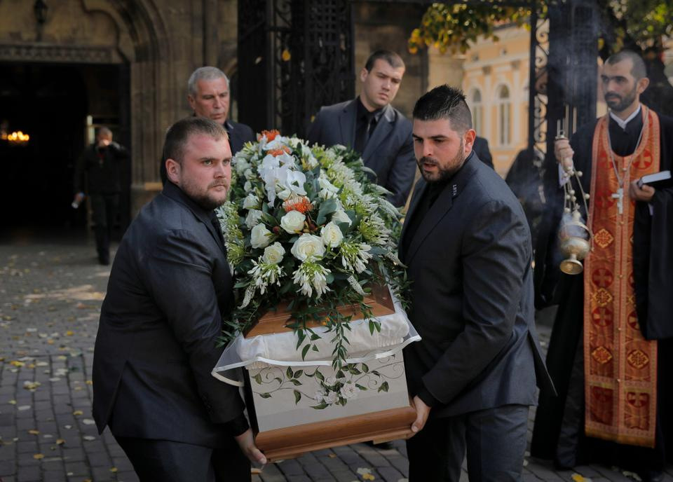 Pallbearers carry the coffin of TV journalist Viktoria Marinova prior to her funeral in Ruse, Bulgaria, Friday, October 12, 2018.