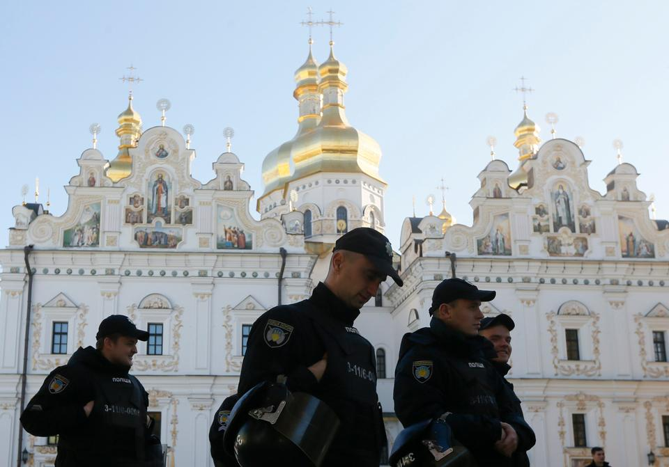 Policemen patrol the territory of the Kiev Pechersk Lavra monastery in Kiev, Ukraine on October 14, 2018.