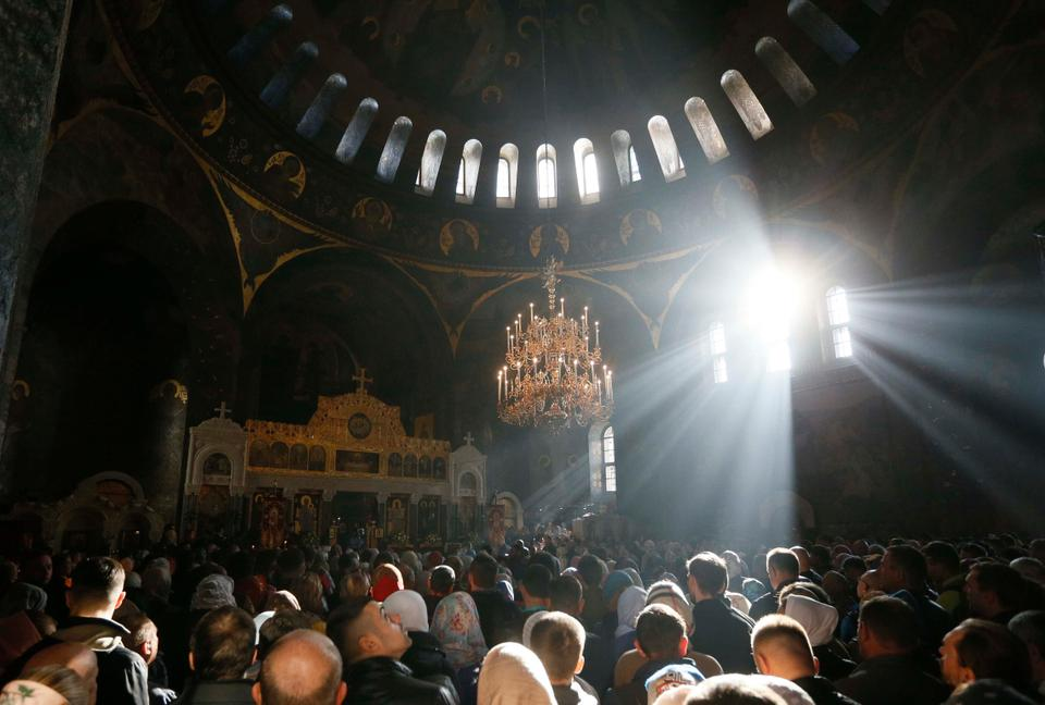 People attend a prayer at the Kiev Pechersk Lavra monastery in Kiev, Ukraine on October 14, 2018.