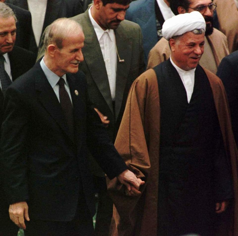 Bashar al Assad's father Hafez Assad also had strong ties with Iran. Hafez Assad, left, with Iran's Head of Expediency Council and former President Hashemi Rafsanjani during a 1997 meeting in Tehran (AP).