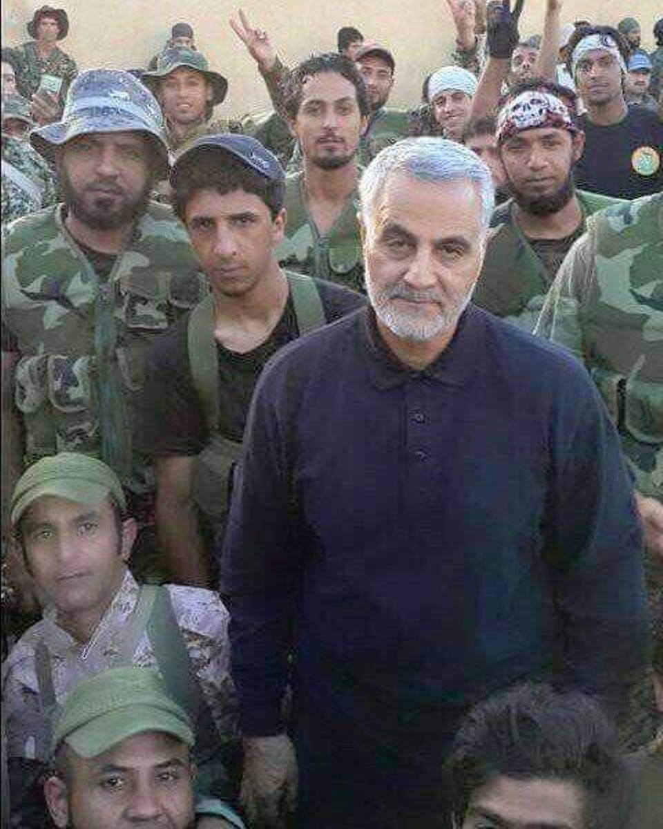 The Iranian General Qasem Suleimani masterminded the creation of Assad's National Defence Force. He is shown with Iraqi militia fighters in Aleppo in this photo released by the Iraqi militia group Harakat al Nujaba in October 2016.