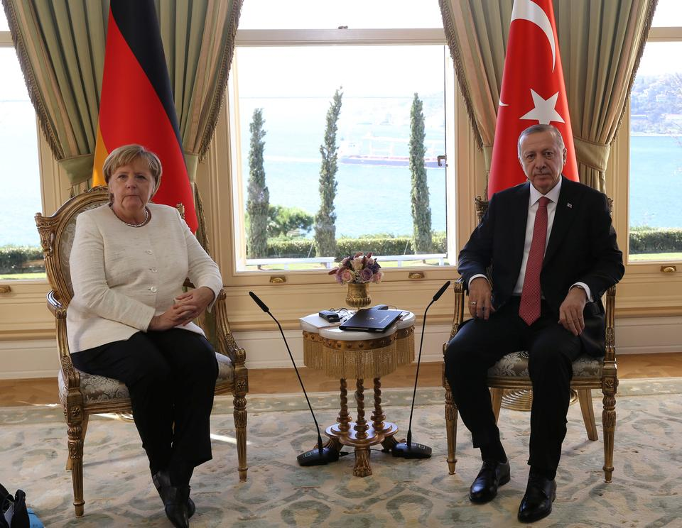 President Erdogan meets German Chancellor Angela Merkel prior to a summit on Syria.