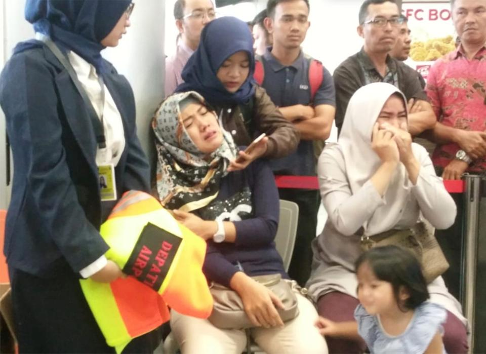 Relatives of passengers of Lion Air flight that crashed into the sea, cry at Depati Amir airport in Pangkal Pinang, Indonesia, October 29, 2018.