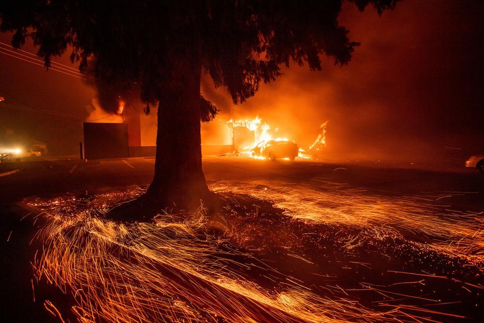 Flames consume a fast food restaurant as the Camp Fire tears through Paradise, Calif., on Thursday, Nov. 8, 2018.