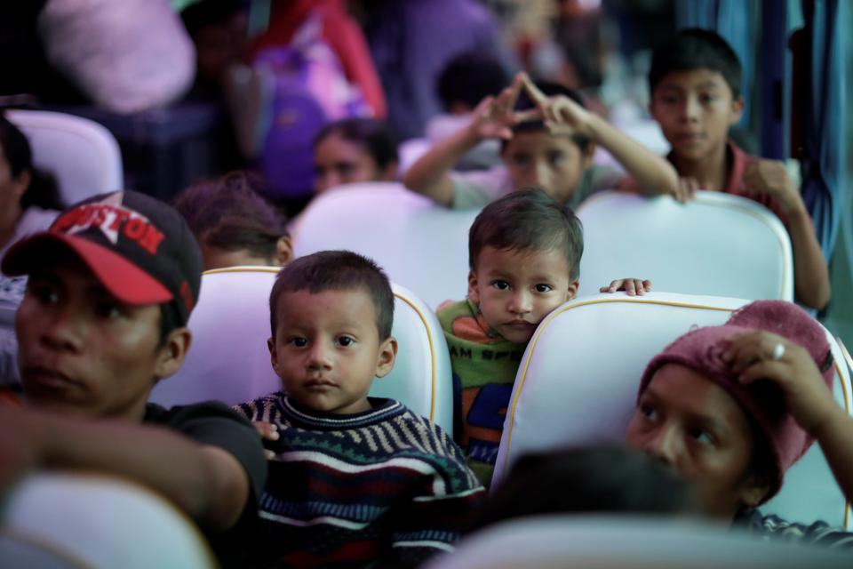 Migrants, part of a caravan traveling from Central America en route to the United States, are seen inside a bus in Juan Rodriguez Clara, Mexico, November 13, 2018.