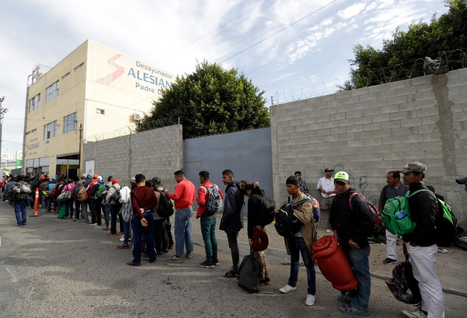 Central American migrants wait in line for a meal at a shelter in Tijuana, Mexico on November 14, 2018.