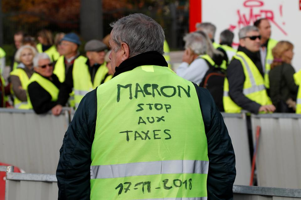 A man takEs part in the nationwide yellow vest demonstrations, a symbol of a French drivers' protest against higher fuel prices, on the Promenade des Anglais in Nice, France, November 17, 2018.