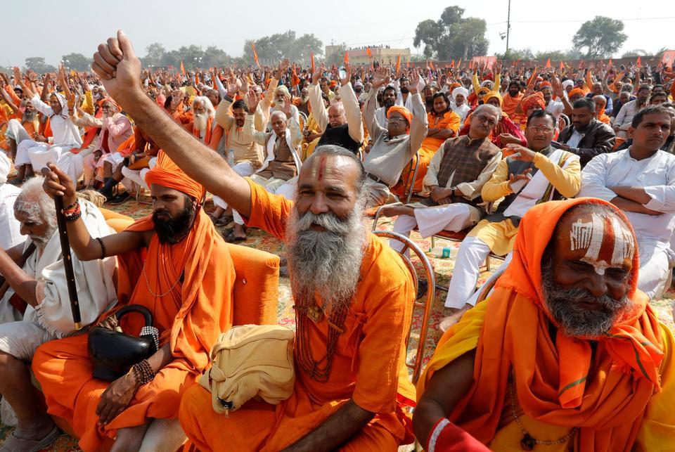 Sadhus or Hindu holymen shout slogans during