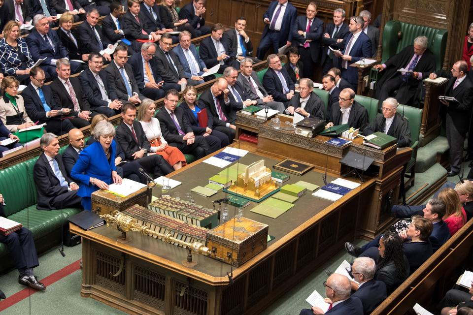 A handout photograph released by the UK Parliament shows Britain's Prime Minister Theresa May attending the weekly Prime Minister's Questions (PMQs) in the House of Commons in London on December 19, 2018.