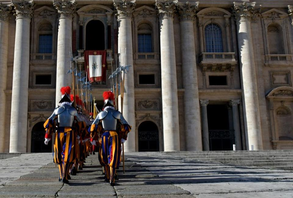 Swiss guards parade before the arrival of the Pope for the traditional