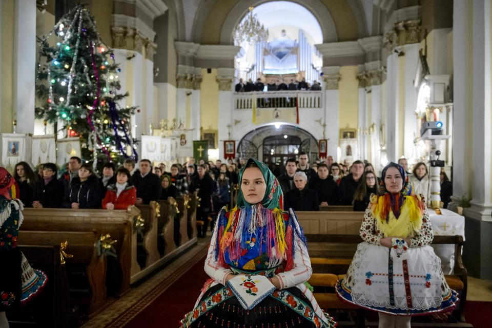 Faithful in folk costumes attend the Midnight Mass on Christmas Eve in Saint Martin of Tours' Church in the village of Bujak, 84 kms northeast of Budapest, Hungary.