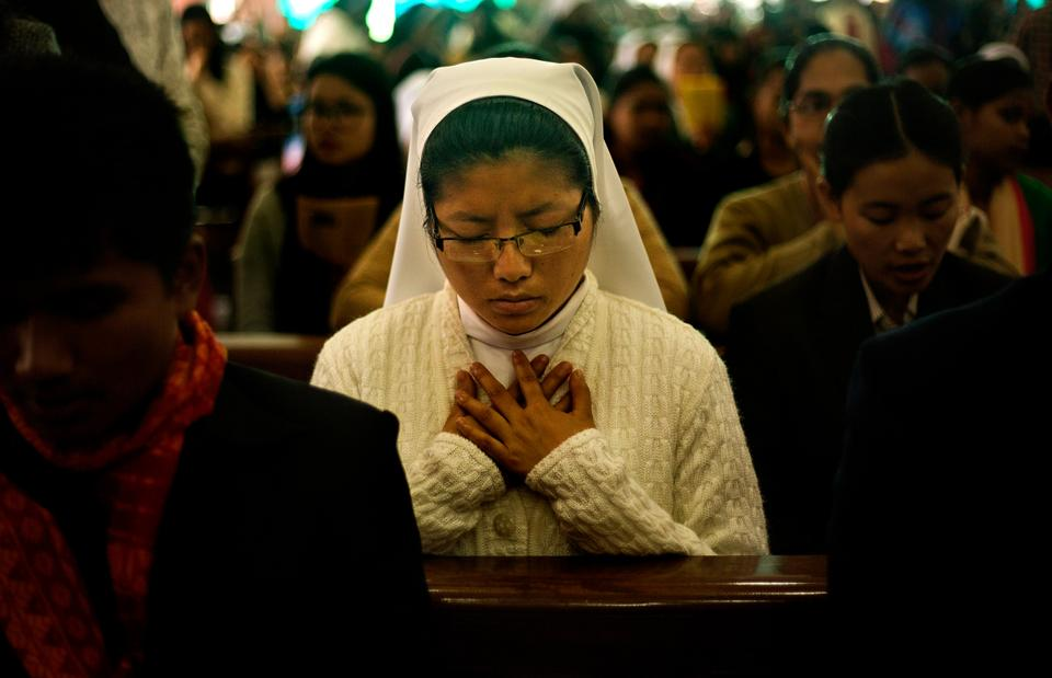 An Indian Christian nun attends Christmas prayers in a church in Gauhati, India.