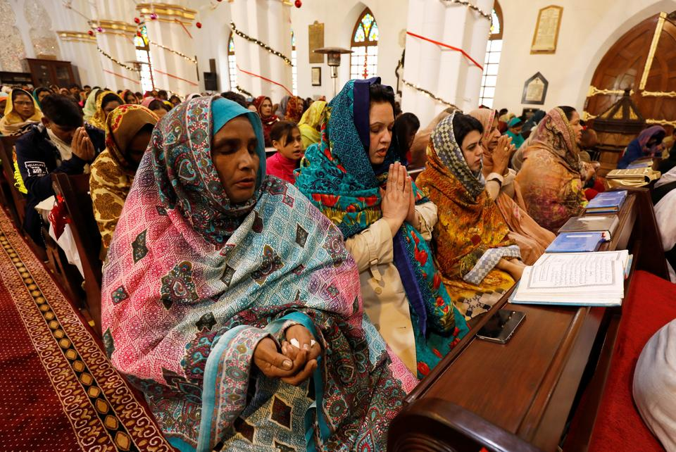 People attend the Christmas service at the St. John's Cathedral in Peshawar, Pakistan.