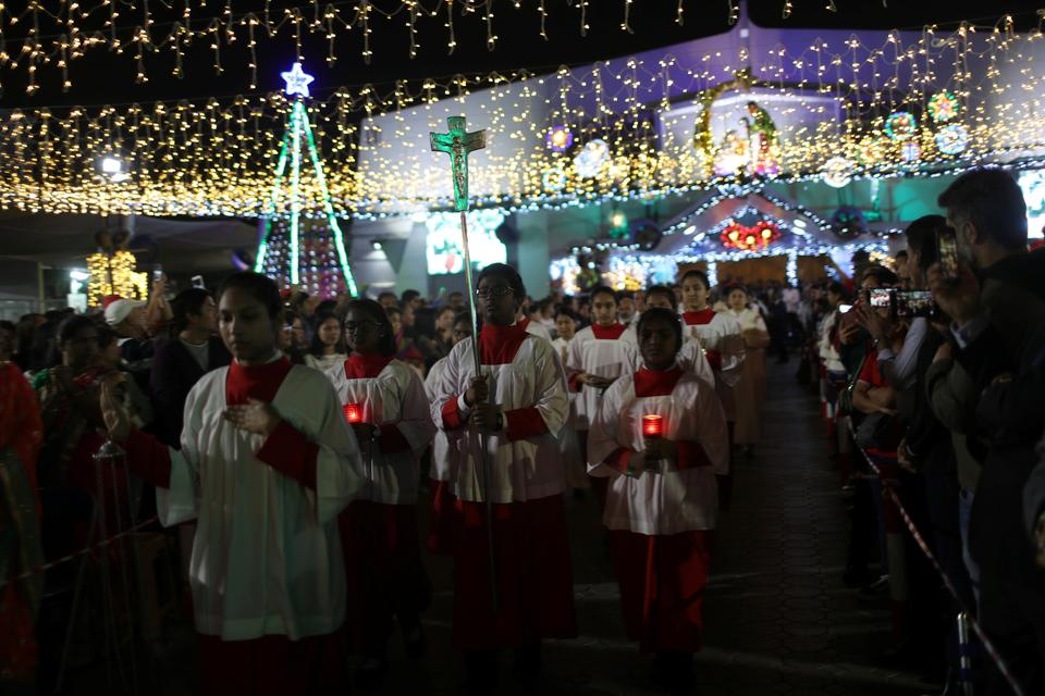 Members of the Christian expatriate community attend a mass on Christmas eve at Santa Maria Church in Dubai, United Arab Emirates.