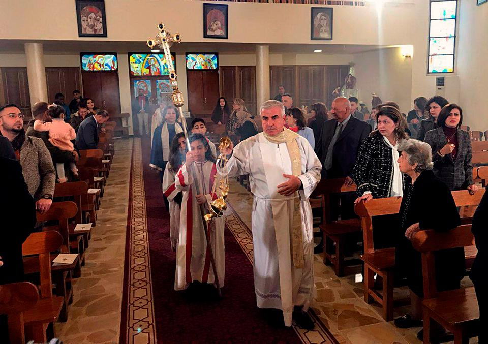 Iraqis attend Christmas Mass at Mar Youssif Chaldean Church, in Baghdad, Iraq.