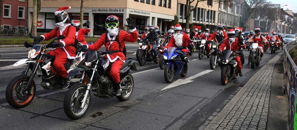 Members of a bikers' club in Santa Claus costumes ride their bikes in Freiburg, southern Germany, on Christmas Eve Monday.