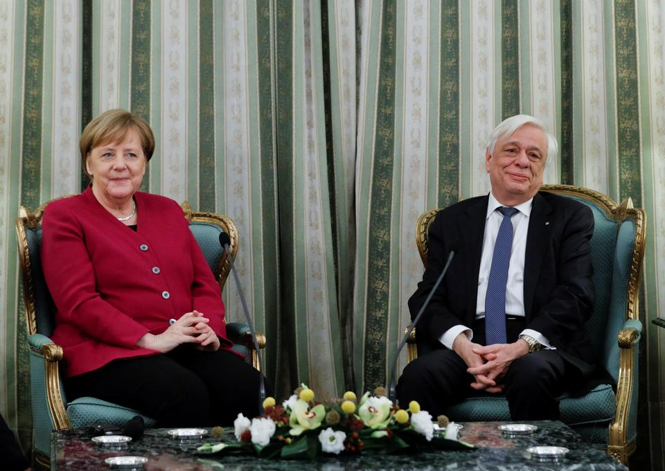 Greek President Prokopis Pavlopoulos meets with German Chancellor Angela Merkel at the Presidential Palace in Athens, Greece, January 11, 2019.