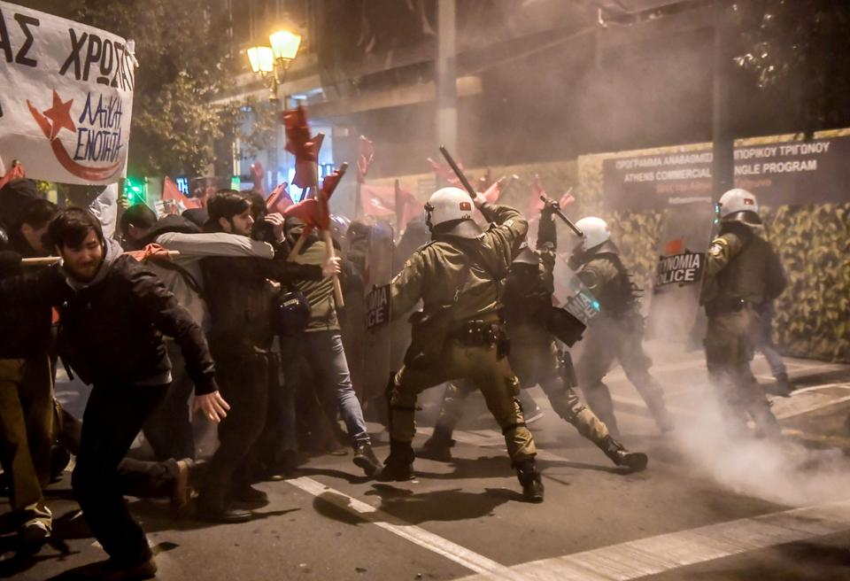Protesters clash with riot police during a demonstration against the visit of German Chancellor Angela Merkel in Athens on January 10, 2019.