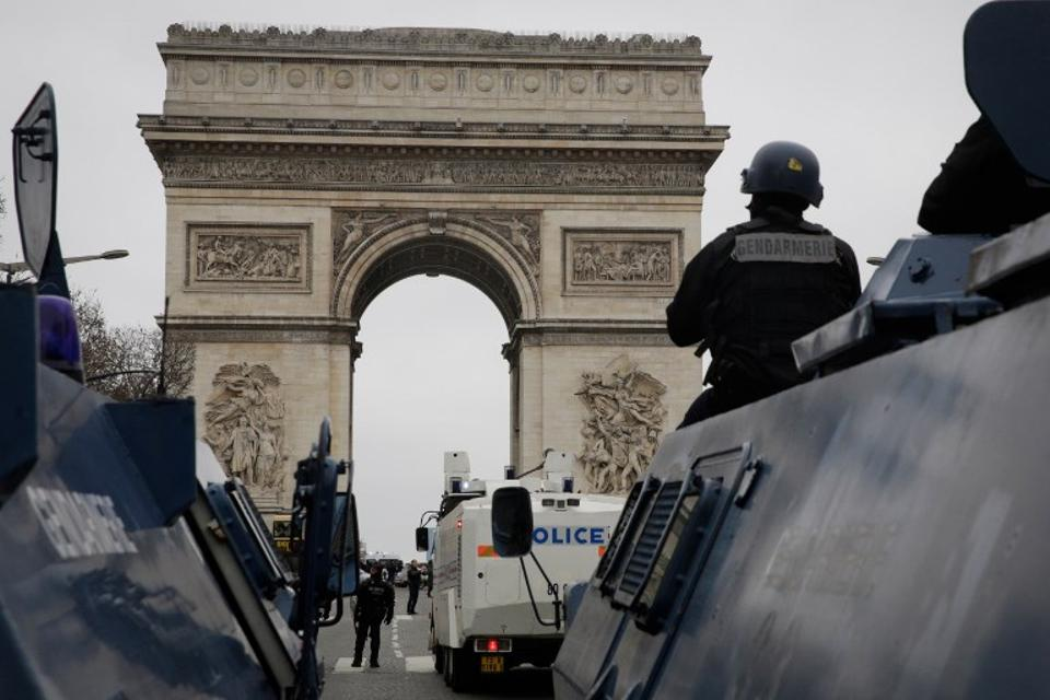 French gendarmes stand guard with their armoured vehicles (VBRG) in front of the Arc de Triomphe on the Champs-Elysees avenue, during an anti-government demonstration called by the Yellow Vest movement in Paris, on January 12, 2019.