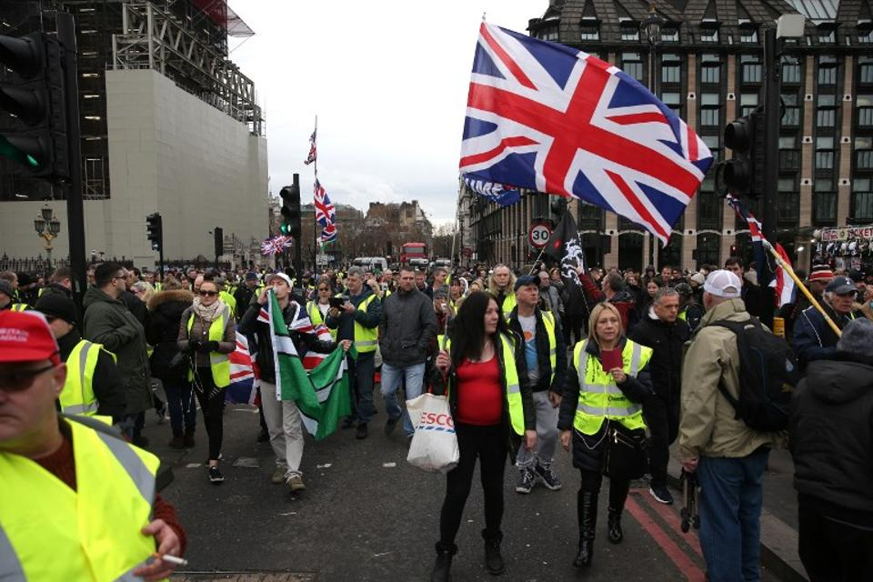 Pro-Brexit protesters wearing yellow vests take part in a demonstration in central London on January 12, 2019.