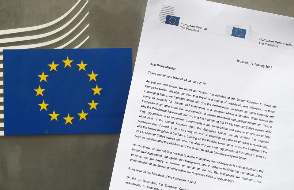 A copy of the letter sent by European Council President Donald Tusk and European Commission President Jean-Claude Juncker to British Prime Minister Theresa May is seen next to a European Flag in this illustration picture, January 14, 2019.