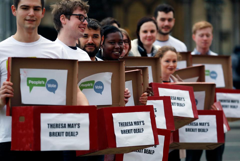 Activists from the People's Vote campaign show 'Deal or No Deal' boxes in London on January 14, 2019. Britain's Prime Minister Theresa May is struggling to win support for her Brexit deal in Parliament. Lawmakers are due to vote on the agreement Tuesday, and all signs suggest they will reject it, adding uncertainty to Brexit less than three months before Britain is due to leave the EU on March 29.
