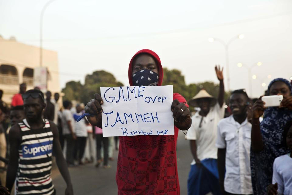 - In this Thursday, Jan. 19, 2017 file photo, a man holds a banner as Gambians cheers in Serrekunda, Gambia. Gambians heaved a sigh of relief when longtime dictator Yahya Jammeh flew into exile in early 2017 after a surprise election defeat. Two years after a
