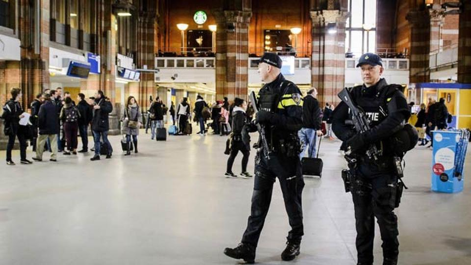 Dutch officers carry out extra patrols at the Central Station in Amsterdam, The Netherlands, 22 March 2016 following the triple bomb attacks in the Belgian capital that killed about 35 people.