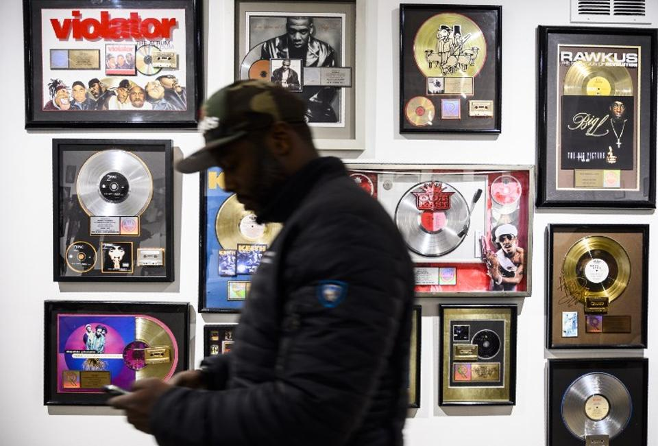 In this file photo taken on January 19, 2019 Guests look at memorabilia at the Hip-Hop Museum Pop Up Experience in Washington, DC.
