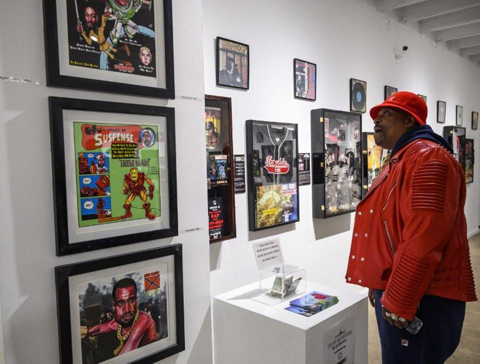 In this file photo taken on January 19, 2019 Curtis Fisher, aka Grandmaster Caz looks at Hip-Hop memorabilia at the Hip-Hop Museum Pop Up Experience in Washington, DC.