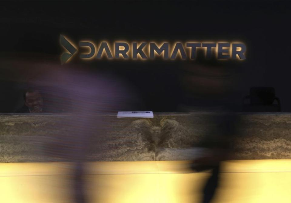 Employees walk into offices of the cybersecurity firm DarkMatter, in Abu Dhabi, United Arab Emirates. DarkMatter, a cybersecurity company that's recruited Western intelligence analysts, and is accused of illegal espionage.