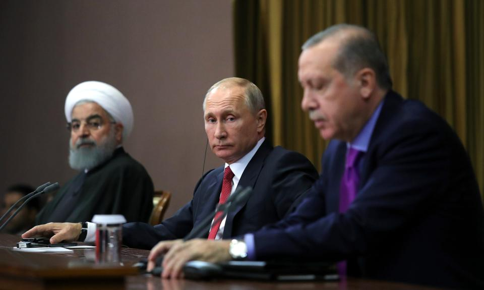 Turkey's President Recep Tayyip Erdogan (R), Russia's President Vladimir Putin (C), and Iran's President Hassan Rouhani attend a news conference in Russia's Black Sea resort of Sochi, Russia on November 22, 2017.