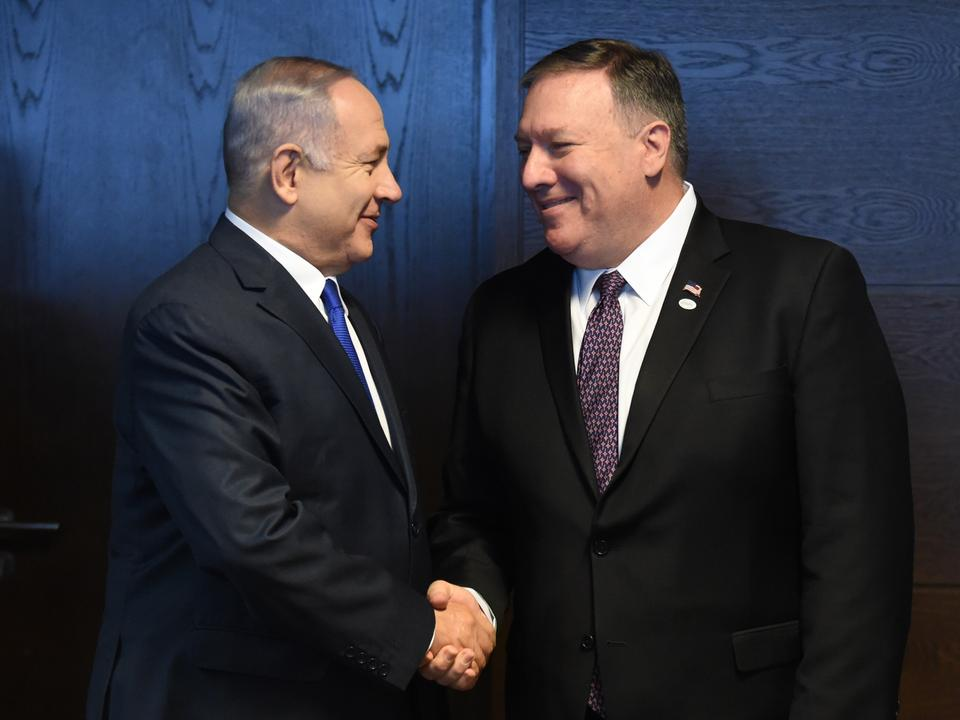 Israel's Prime Minister Benjamin Netanyahu (L) shakes hands with US Secretary of State Mike Pompeo (R) as they talk to the press on the sidelines of a session at the conference on Peace and Security in the Middle East in Warsaw. February 14, 2019.