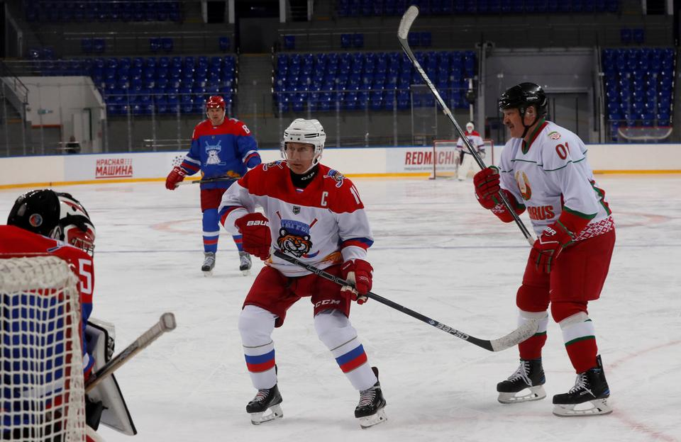 Russian President Vladimir Putin and Belarusian President Alexander Lukashenko (R) play an ice hockey game at Shayba Arena in the Black Sea resort of Sochi, Russia February 15, 2019.