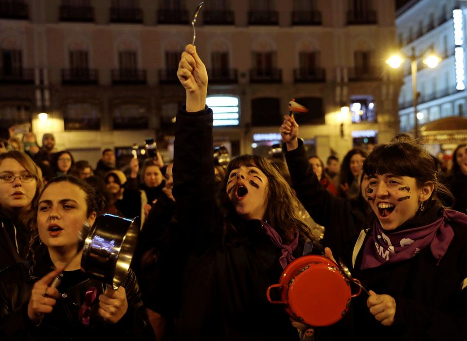 Women bang pots and pans during a protest at the start of a nationwide feminist strike on International Women's Day at Puerta del Sol Square in Madrid, Spain, March 8, 2019.