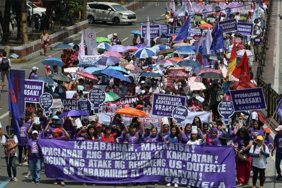 Activists from Gabriela march toward Malacanang palace to commemorate International Women's Day in Manila on March 8, 2019.