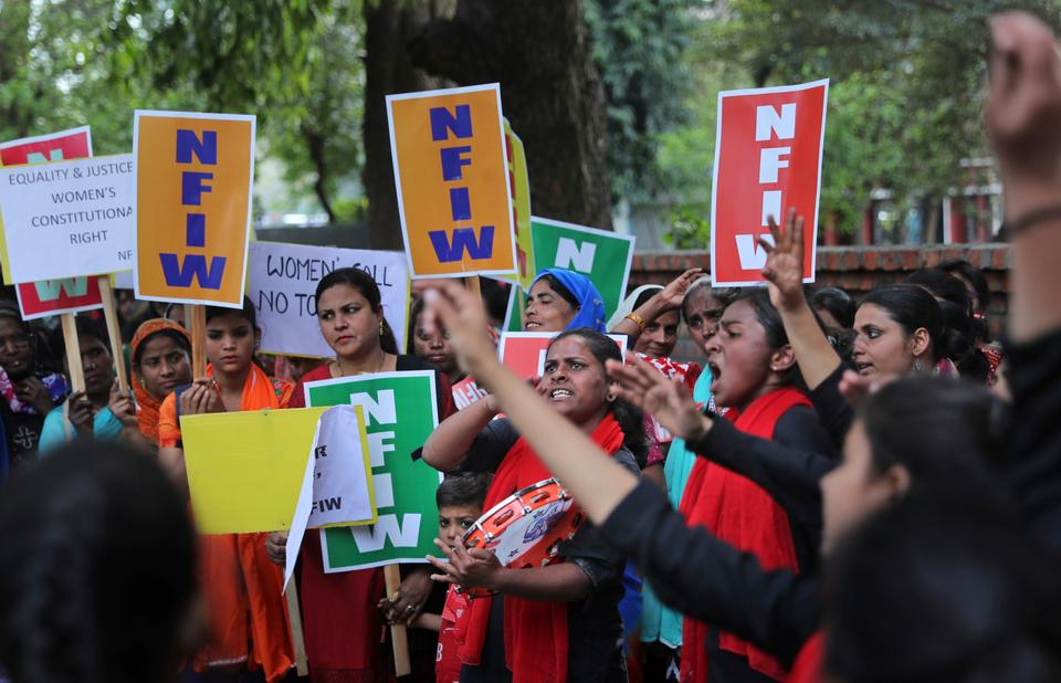 Indian women shout slogans during a march to mark International Women's Day in New Delhi, India, Friday, March 8, 2019.