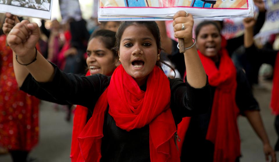 IIndian women shout slogans during a march to celebrate International Women's Day in New Delhi, India, Friday, March 8, 2019.