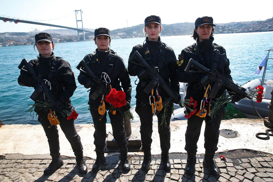 To mark International Women's Day, Turkish female gendarmerie officers pose for photographs after they rappelled off Istanbul's 'July 15th Martyrs' Bridge', on Friday, March 8, 2019.