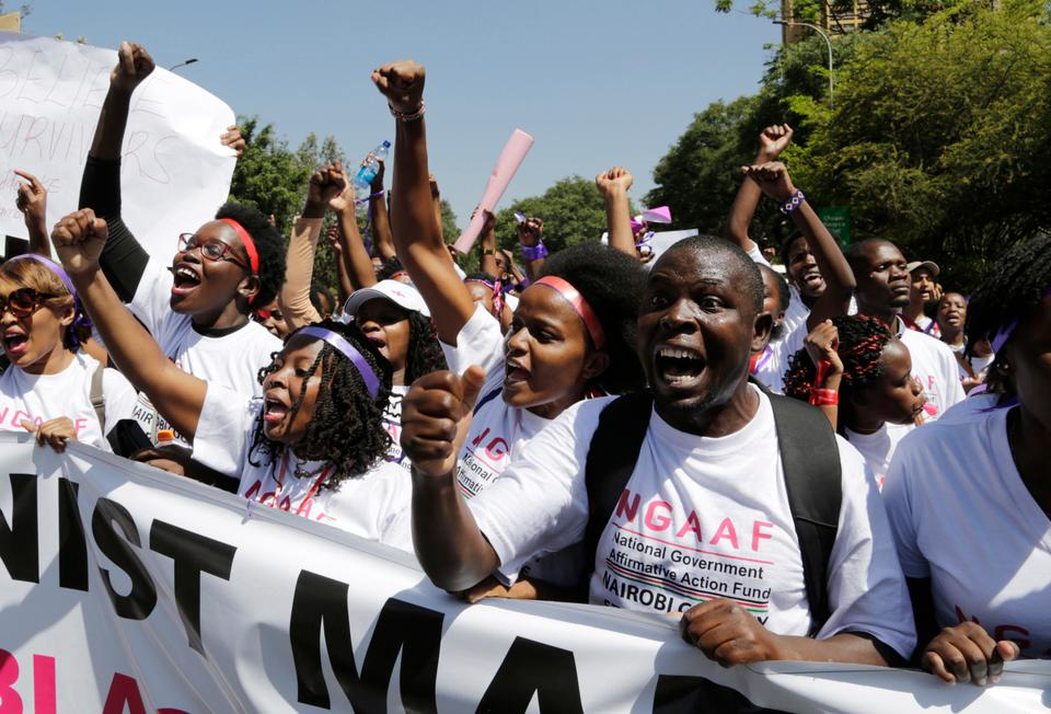 Kenyan people shout slogans during a march to mark International Women's Day in Nairobi, Kenya on Friday March 8, 2019.