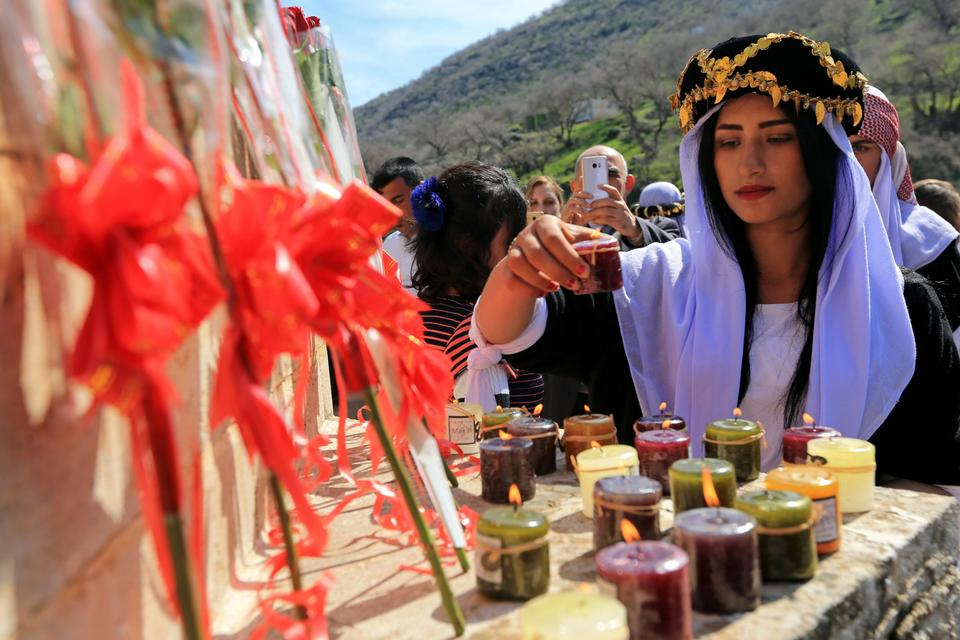 A Yazidi woman attends candle lighting ceremony for Daesh victims at Lilash Temple in Sinkhan region during the International Women Day on March 08 , 2019.