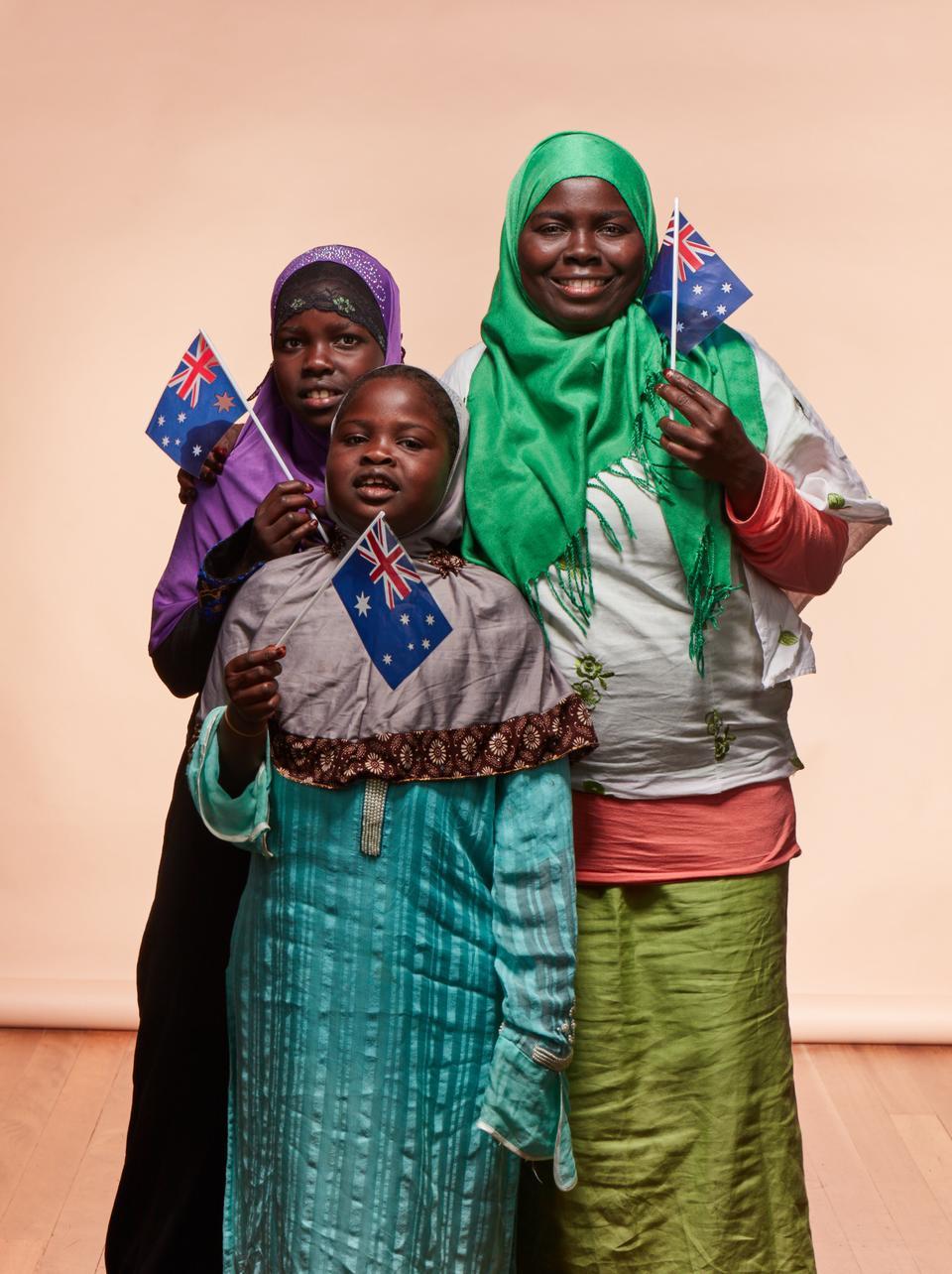 Asha Gombu (right) and her kids Khadija and Batool.